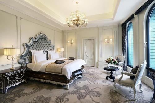 A bed or beds in a room at Ambassadori Tbilisi Hotel