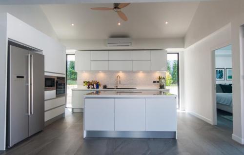 A kitchen or kitchenette at Seaview Pool Villa 3BR, Long Beach - Monkey Villa