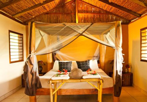 A bed or beds in a room at Totoco Eco-lodge