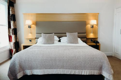 A bed or beds in a room at Crown Spa Hotel Scarborough by Compass Hospitality