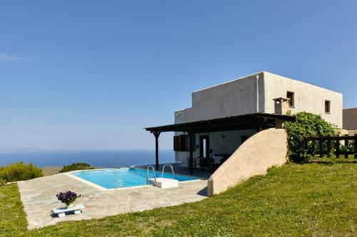 The swimming pool at or close to The Pool Garden House with a fantastic sea and sunset view