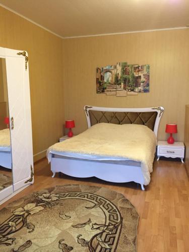 Кровать или кровати в номере Elizaveta