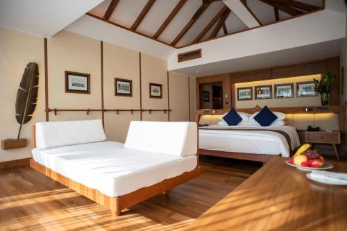 A bed or beds in a room at Bayview - The Beach Resort