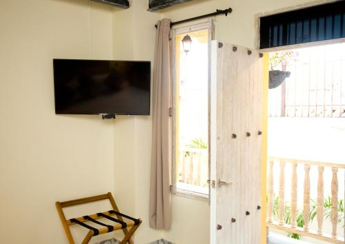 A television and/or entertainment center at Maloka Boutique Hostel
