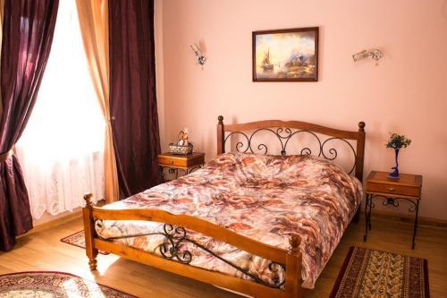 A bed or beds in a room at Agrousadba Belovezhskaya Gostevaya