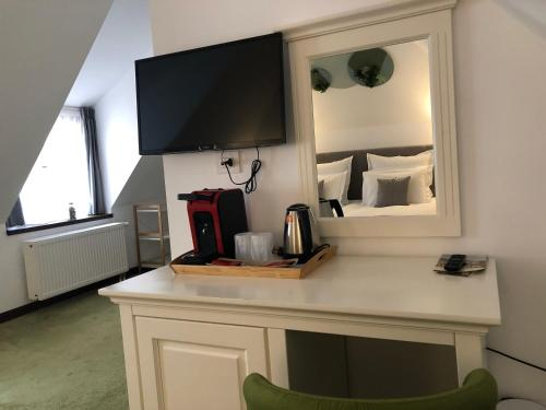A television and/or entertainment center at Arce Boutique Hotel