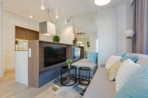 Telewizja i/lub zestaw kina domowego w obiekcie Apartament Różana