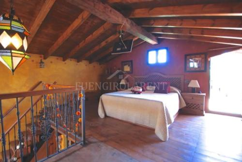 A bed or beds in a room at Casa de Campo Relax