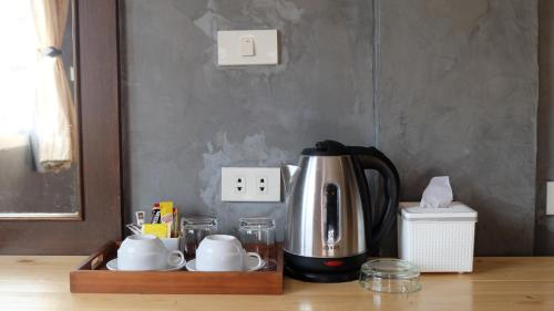 Coffee and tea-making facilities at 18 Coins Cafe & Hostel