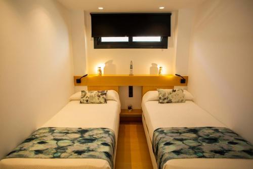 Un ou plusieurs lits dans un hébergement de l'établissement Hostal Sevilla Santa Justa - Adults only