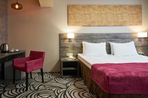 Кровать или кровати в номере Гостиница Адмиралтейская