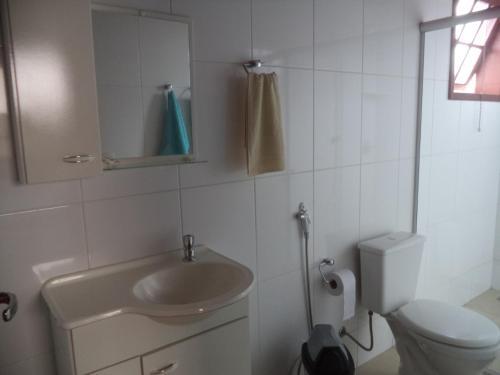 Um banheiro em Pousada Dona Denis