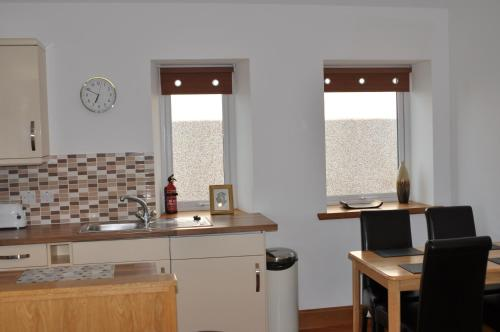 A kitchen or kitchenette at Orkney Villlas