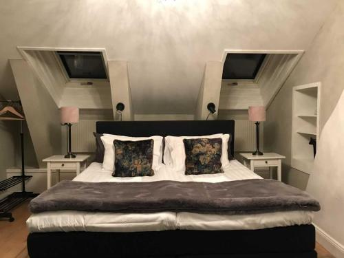 A bed or beds in a room at Lilla Brunn