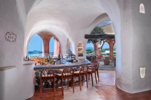 A restaurant or other place to eat at Hotel Cala di Volpe, a Luxury Collection Hotel, Costa Smeralda