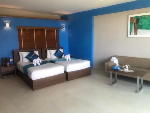 A bed or beds in a room at Maya Koh Lanta Resort