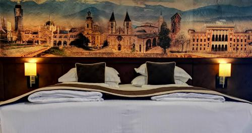 A bed or beds in a room at Hotel President Sarajevo