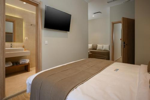 A bed or beds in a room at Minaret Suites and Apartments