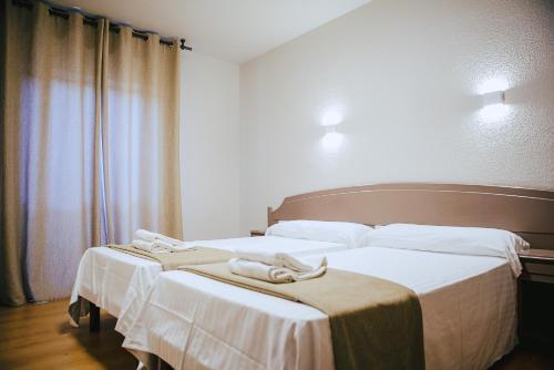 Cama o camas de una habitación en Hotel Ducay