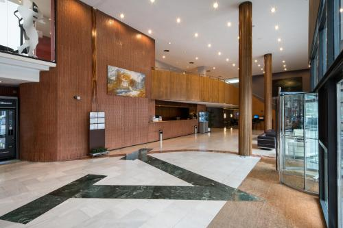 The lobby or reception area at Catalonia Gran Hotel Verdi