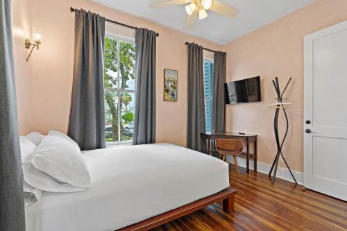 A bed or beds in a room at Domum de Vencé
