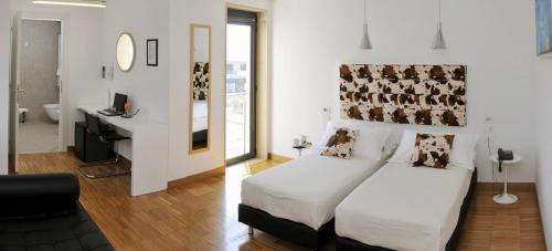 A bed or beds in a room at Hotel Del Conte