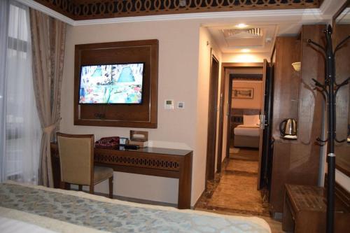 تلفاز و/أو أجهزة ترفيهية في فندق فيوليت العزيزية