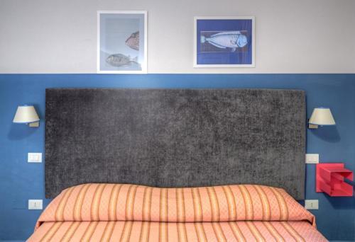 Кровать или кровати в номере Albergo Bargino