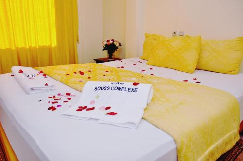 A bed or beds in a room at Hotel Ribis