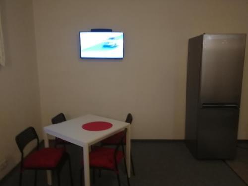 Телевизор и/или развлекательный центр в Hotel M&M