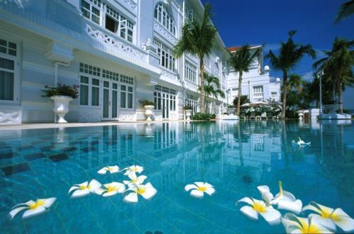 The swimming pool at or near Eastern & Oriental Hotel