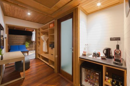 A kitchen or kitchenette at Vilamendhoo Island Resort & Spa