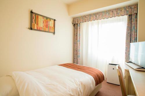 ANA ホリデイ・イン リゾート 宮崎にあるベッド