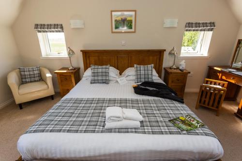 A bed or beds in a room at Ulbster Arms Hotel