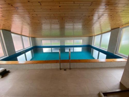 The swimming pool at or close to Penzion Pod Zámkem