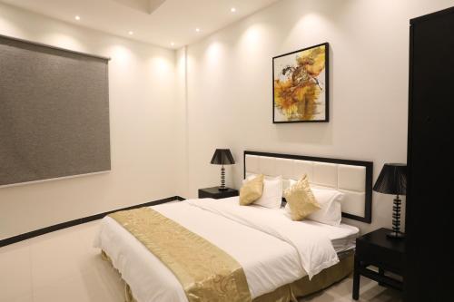 Cama ou camas em um quarto em Quiet Rooms Suites