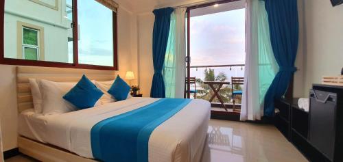 Cama o camas de una habitación en Huvan Beach Hotel at Hulhumale'