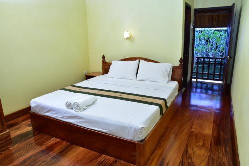 Ein Bett oder Betten in einem Zimmer der Unterkunft Villa Somphong Namkhan View