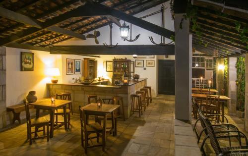 Um restaurante ou outro lugar para comer em Pousada Pardieiro