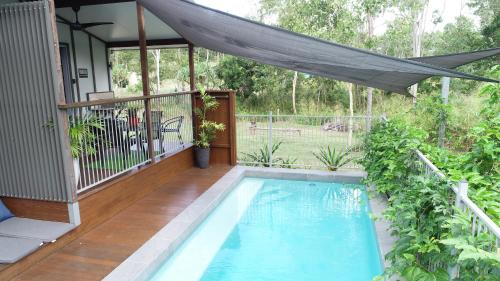 The swimming pool at or near Woodwark Bay Retreat Airlie Beach