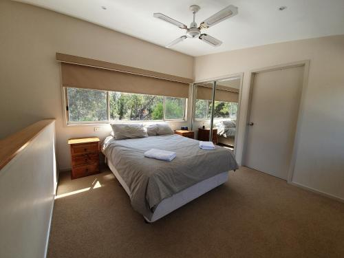 A bed or beds in a room at Waterfront Retreat At Wattle Point