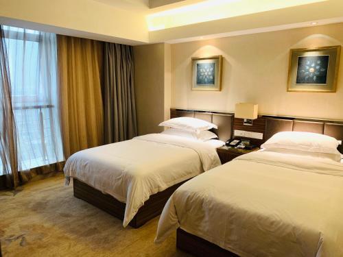 イーウー ウェンデム インターナショナル ホテルにあるベッド