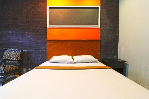 A bed or beds in a room at Eve Guest House