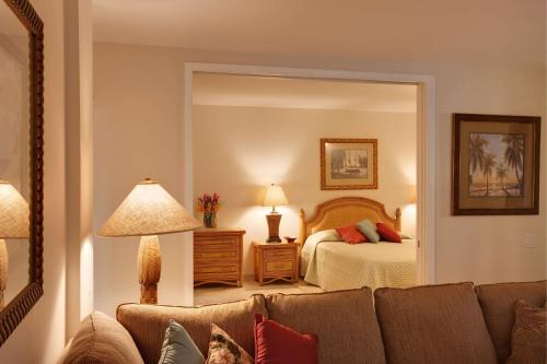 A bed or beds in a room at Kaanapali Alii, a Destination by Hyatt Residence