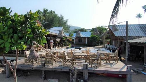 A restaurant or other place to eat at Lanta New Coconut Bungalow - SHA Plus