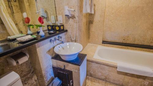 A bathroom at The Lokha Legian Resort & Spa