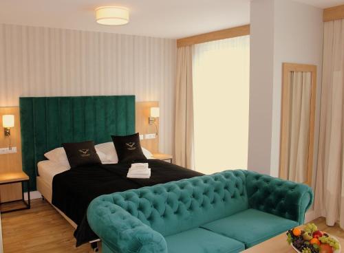Łóżko lub łóżka w pokoju w obiekcie Hotel Echo