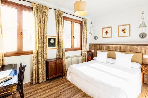 Cama o camas de una habitación en Hotel Spa Salinas de Imón