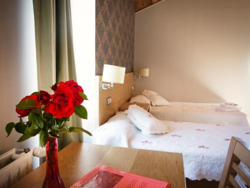 Cama o camas de una habitación en Complexo Xacobeo