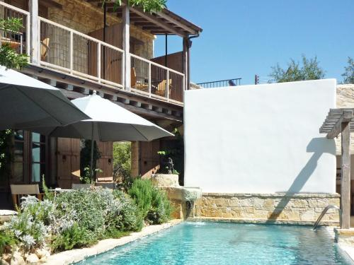 The swimming pool at or near Apokryfo Traditional Guesthouse